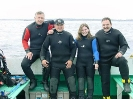 Doug Carmichael, Terry Dwyer, Suzie Dwyer and Gabe Carrier after a dive on the PORTIA in Sambro, Nova Scotia