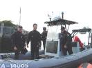 Safety Divers Sam Millett and Blair Christian with two RCMP Officers on the set of the feature film - The Shipping News, starring Kevin Spacey.