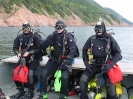 From left to right, Sam Millett, Steve Dugas and Terry Dwyer prepare for a wreck dive near Cape North, Cape Breton Island.