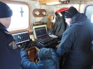 RCMP Members adjusting the sonar search / survey lines