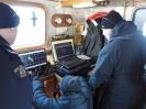RCMP Members adjusting the sonar search / survey lines
