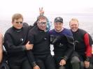 Terry Dwyer, Harry Dort, Sam Millett and Robert Guertin in between dives in Louisbourg Harbour.