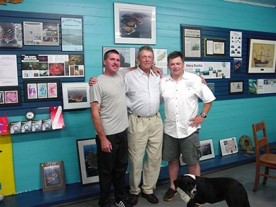 Capt. Scott Fitzgerald, Ron Laing (former resident of St. Paul Island) and Terry Dwyer in the Wreck Hunter shipwreck museum in Dingwall.