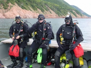 From left to right, Sam Millett, Steve Dugas and Terry Dwyer prepare for a wreck dive near Cape North, Cape Breton Island