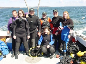 Harry Dort, Stephanie HilIison, Terry Dwyer Andy Olsson, Suzie Dwyer (kneeling) Robert Guertin and Ally Wynn in between dives on the Costa Rican Trader in Halifax Harbour